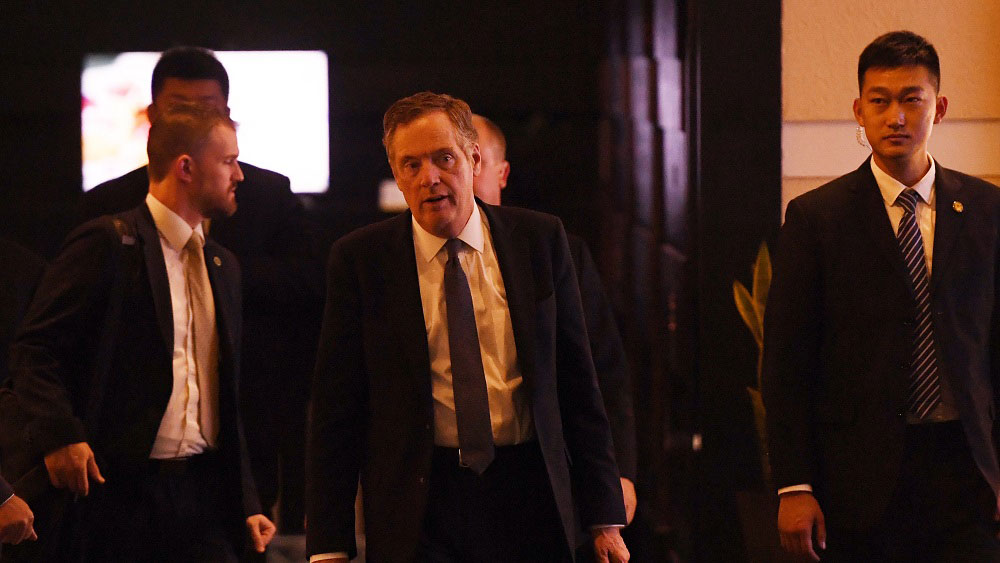 Robert Lighthizer walks through a hotel lobby